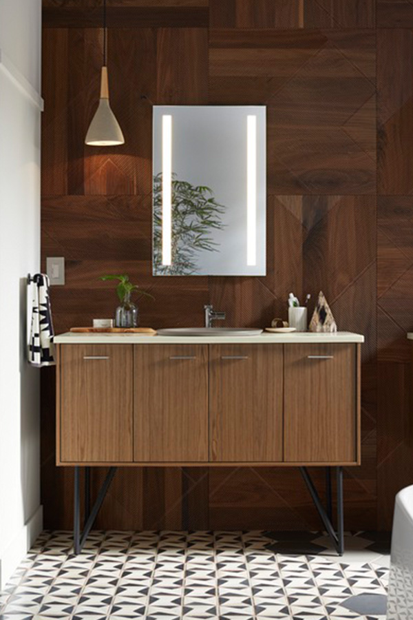 Contemporary bathroom with dual lighted medicine cabinets, wood vanities, and modern faucet designs.