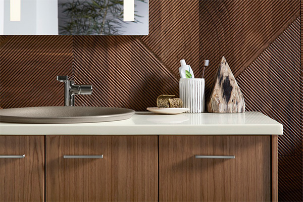 Contemporary bathroom styling space featuring wood vanities and wall tile and taupe hues.