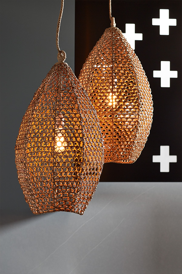 Basket weave pendant lights hand suspended in a kitchen space designed around HUMANature